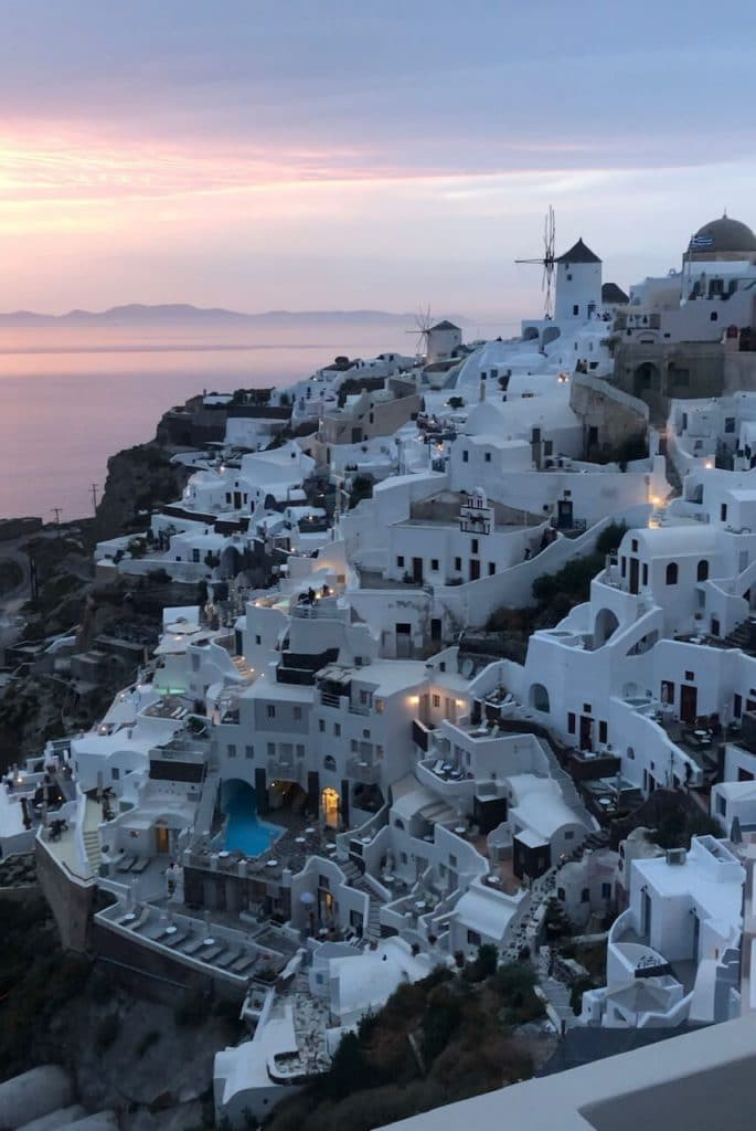 whitewashed houses in the town of Oia, Santorini, during the sunset