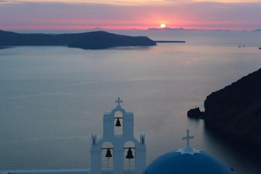 Saint Theodoros Thira Holy Orthodox Church and the sun setting in the background