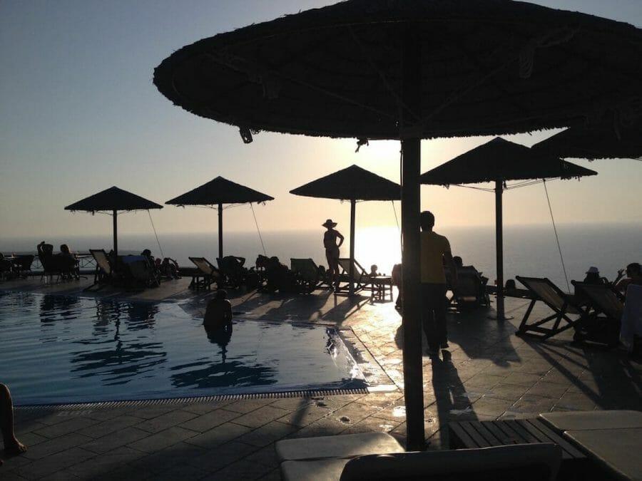 lounge chairs, umbrellas and a swimming pool at Lioyerma Lounge Cafe Pool Bar, Santorini